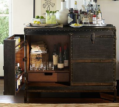 have all of this: a vintage vibe, doors, plenty of room  Pottery Barn - Ludlow Trunk Bar Cabinet