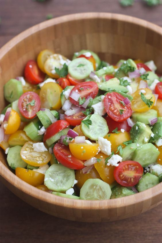 Tomato Cucumber Avocado Salad is the perfect EASY, light and fresh summer side dish.  I have fully embraced Spring. The weather is fantastic and I'm soo ready for lighter food, barbecuing and picnicing outside.  Take this amazing Black Bean Burger, for ex (Best Dinner Menu)