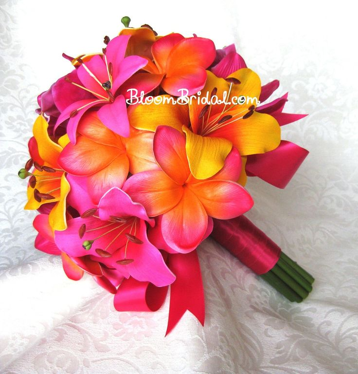 Real touch Fuchsia Orchids, hot pink Lilies, tangerine Lilies, and sunset orange Plumerias. $125.00