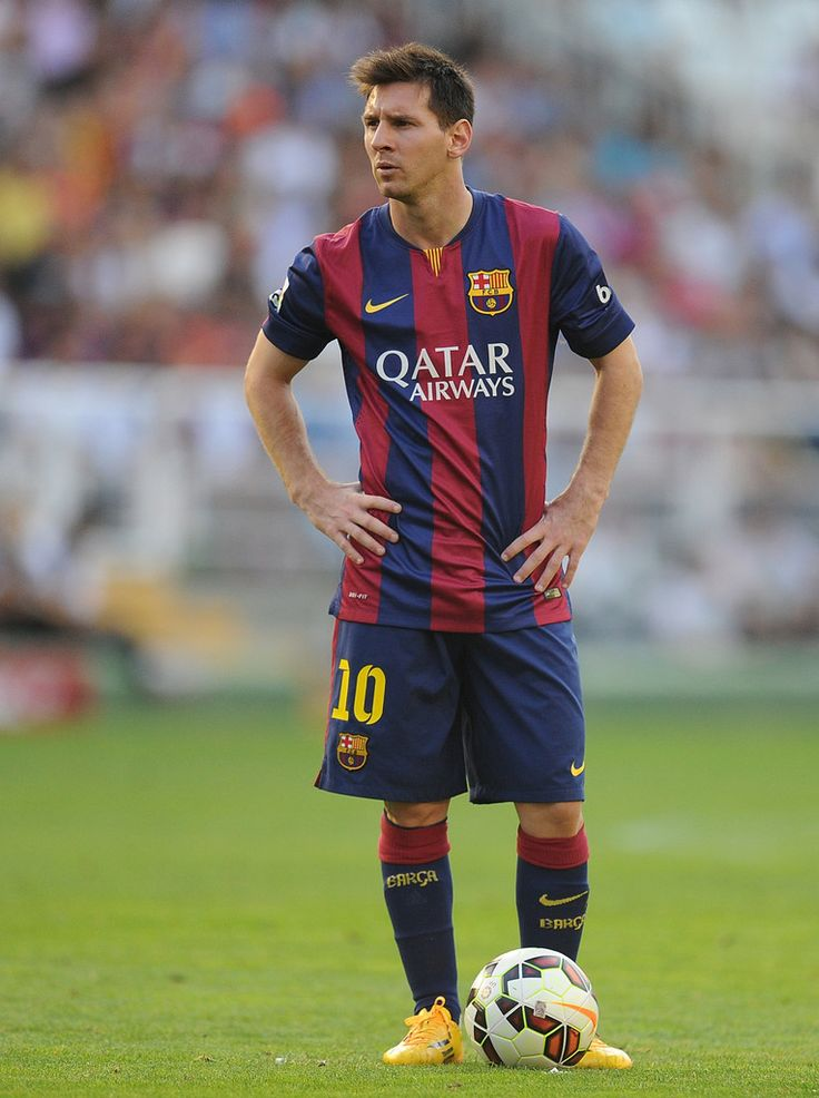 Lionel Messi of FC Barcelona lines-up a free kick during the La Liga match between Rayo Vallecano de Madrid and FC Barcelona at Estadio Teresa Rivero on October 4, 2014 in Madrid, Spain.