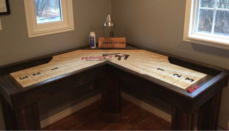 Woody's corner shuffleboard game in the corner of a small apartment.