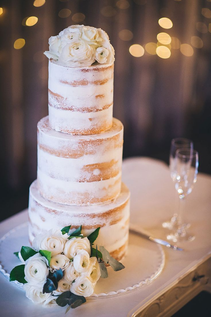 Three tier naked wedding cake with white ranunculus | Luna Imagery