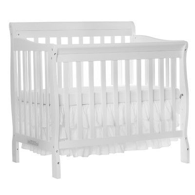 Features:  -Can accommodate standard portable mattress.  -Sits low to the floor.  -Tested for lead and other toxic elements to meet or exceed government and ASTM safety standards..  -Crib will accommo