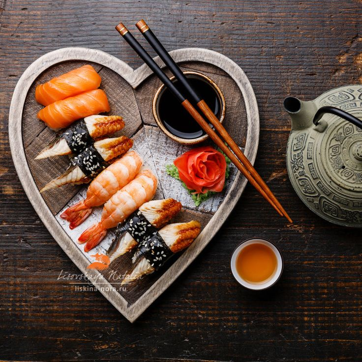 Sushi Set nigiri and tea served on Heart shape wooden tray