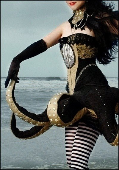If you really wanted the tentacles played up... instead of having the striped tights have the leggings transformed into two tentacles and add 6 more to the ensemble with the dress.... longer though...