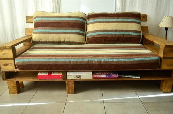 Here is another wonderful couch made by re transforming the wood pallets. It us a two seater couch or sofa with some space at the bottom to keep your items on and it is giving such a beautiful look to your drawing room and it is very inexpensive yet provides the same utility.