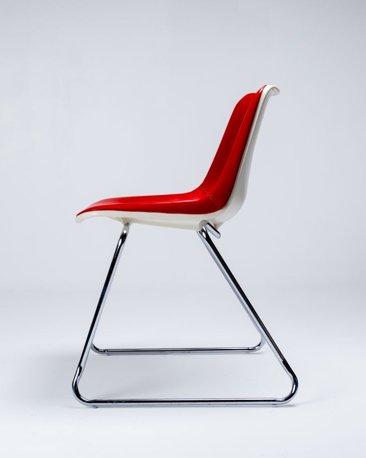 White Polyside chair with original eyecatching red vinyl on a mild steel chrome sled base. The seat base stamped Robin Day Design, Hille, Made In Australia and dated 11/78.