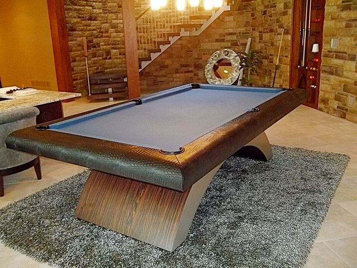 "Golden West ""Halo"" custom pool table recently installed in Iowa. Custom leather rails with a brushed metal and ebony base make up this ultimate one of a kind pool table. AMERICAN BUILT and PROUD of it! GO HAWKS!"