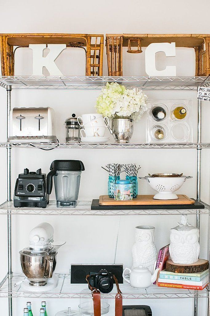 Idea: A lack of cabinet space doesn't have to stop you from owning bulky appliances like KitchenAid mixers and high-powered blenders. Some of the cutest rentals we've seen use stainless steel shelves for stylishly organization, making it easy to keep everything within sight. The best part? You can extend them or shorten them for a customized height.  Get it: This shelving unit is a great starter package.