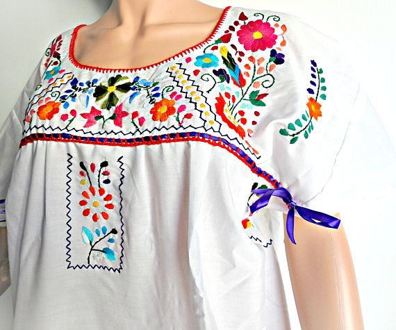 Change your life with colors with this gorgeous white Mexico embroidered dress. #fiestamexicana #mexicandressembroidered #mexicandress #mexicodress #mexicanembroidery #cottonsundress #hippieweddingdress #whitemexicandress #mexicanclothes #mexicandresses #mexicodresses #mexicandresswomen zazaofcanada.com