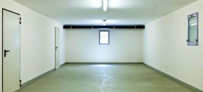 Follow these steps to lay tile on a concrete basement floor.