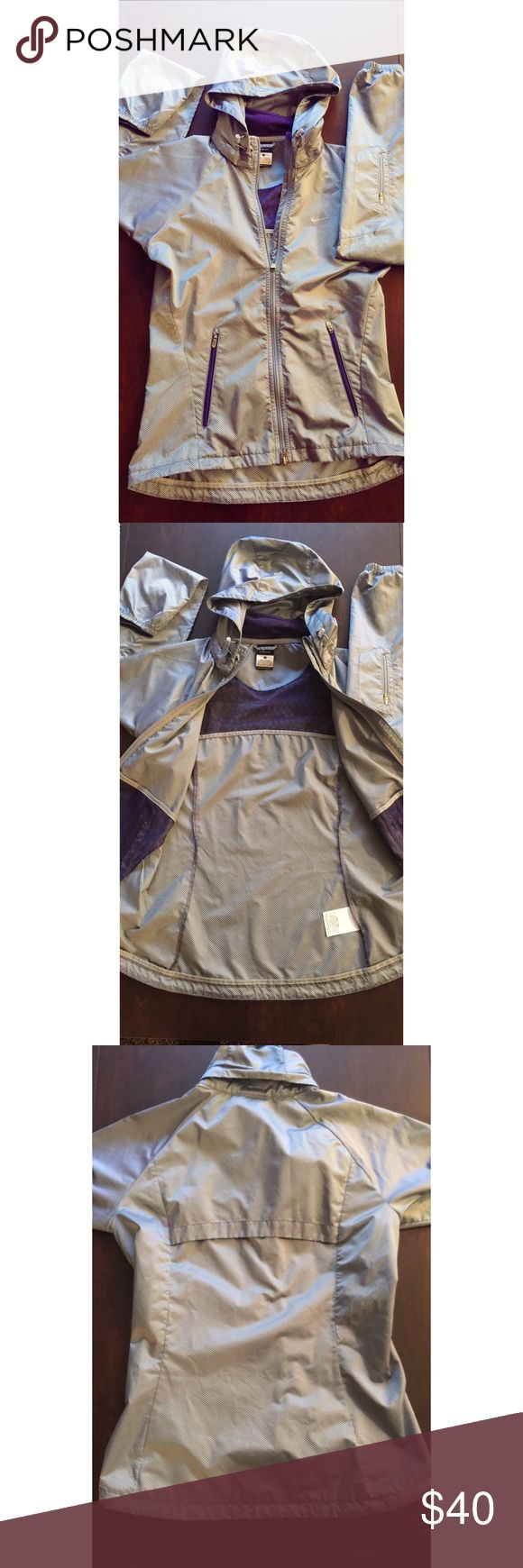 Silver and Purple Nike Rain Jacket Adorable rain jacket - love the purple accent! Originally from Nike, great for the rain and for layering. Removeable hood. Size small and fits like a small. Like new condition. ☔️👌🏻 Nike Jackets & Coats