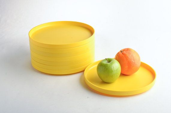 Set of eight bright yellow Heller stackable dinner plates designed by Massimo Vignelli in the mid 1960s. Six are marked Heller Design by Massimo