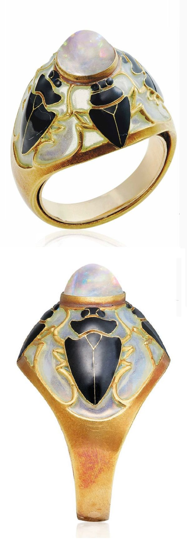 RENÉ LALIQUE - AN ART NOUVEAU MOONSTONE AND ENAMEL RING, CIRCA 1900. Centring a cabochon moonstone, to the window enamel bombé surround, applied with four black enamel scarabs, with French assay mark for gold, signed Lalique