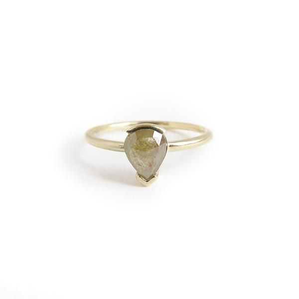RUMI   The Return   A one of a kind 9ct yellow gold ring with channel set rose cut teardrop shaped 0.61ct green diamond.