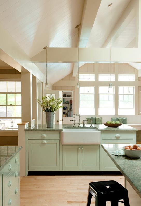 High-beamed ceilings, light filled, colors, and the farm sink