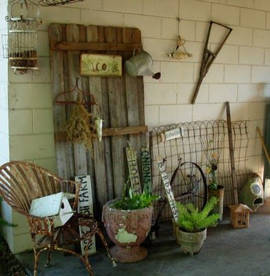 old barn door used for outside decoration hanging watering can very rustic