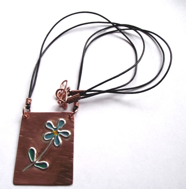 a pure copper pendant with sterling silver flower