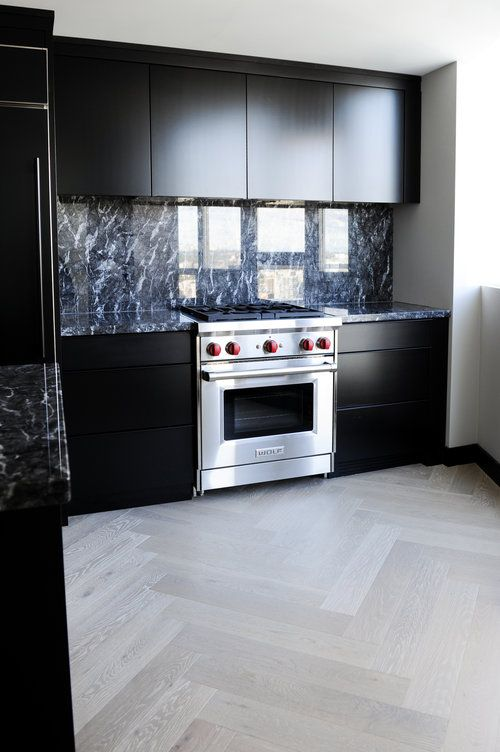 dark sleek modern kitchen design with black cabinets and black marble countertops and backsplash chrissy - Marble Kitchen Design