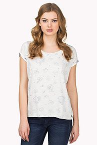 Go inside out this season. Soft cotton slub tee in a straight fit and inverted styling with signature Hilfiger Denim prints and logos scattered all over. Crew neck with keyhole closure at the neck, accent tape along the neckline. Rolled sleeve cuffs emphasize the inside out look. Flag on the sleeve.<br/><br/>Our model is 1.76m and is wearing a size S Hilfiger Denim tee.
