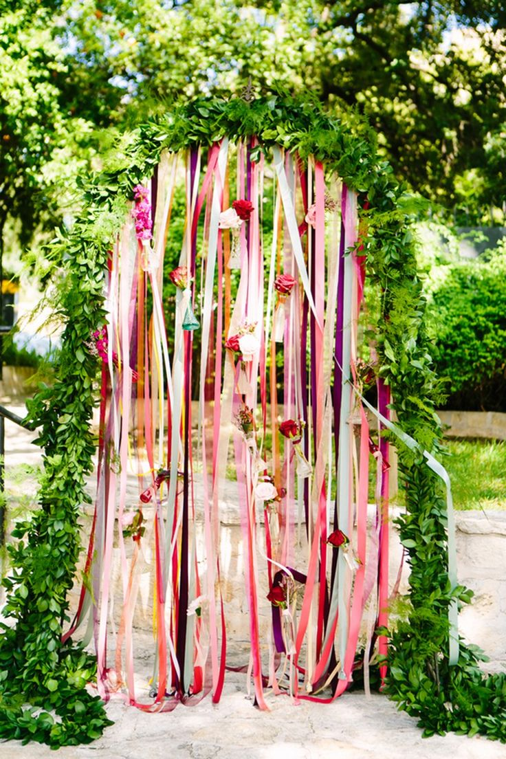 Such cute ceremony decor -- greenery arch with ribbons hanging? LOVE IT!