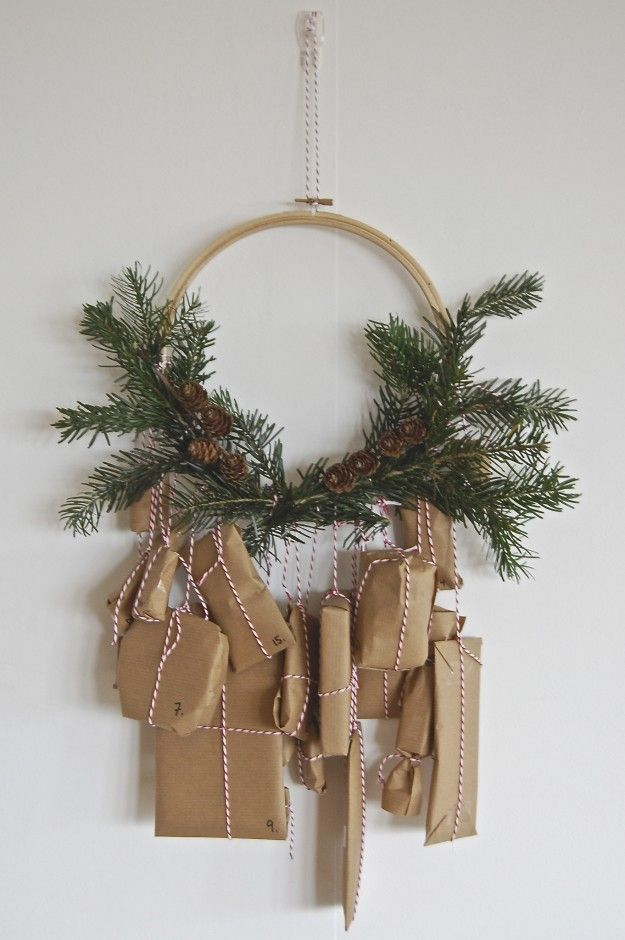 advent calendar -- brown paper packages tied with twine to a minimalist pine wreath