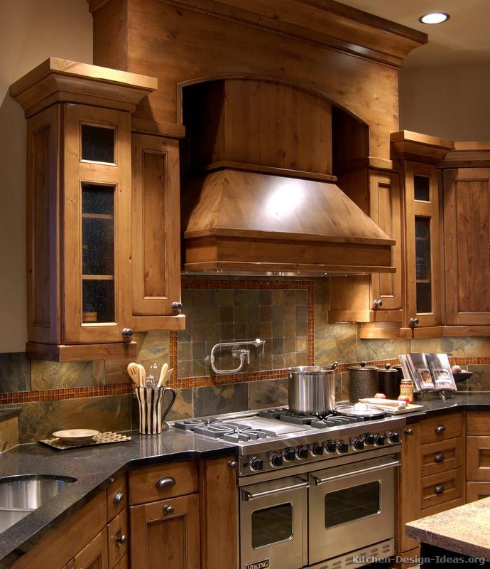 rustic kitchen design with pro viking range large wood hood and slate tile backsplash