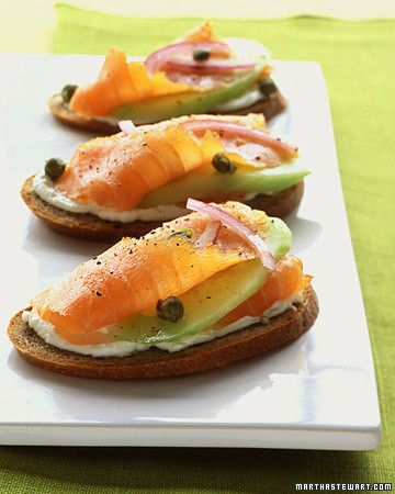 Think of this party piece as a rye bagel with lox gone upscale: The slightly sour taste of rye complements the saltiness of smoked salmon and is cooled by a layer of cream cheese. Garnish these canapes with cucumber, red onion, capers, and a spritz of lemon. Can't get enough of smoked salmon? Try our favorite smoked salmon recipes.