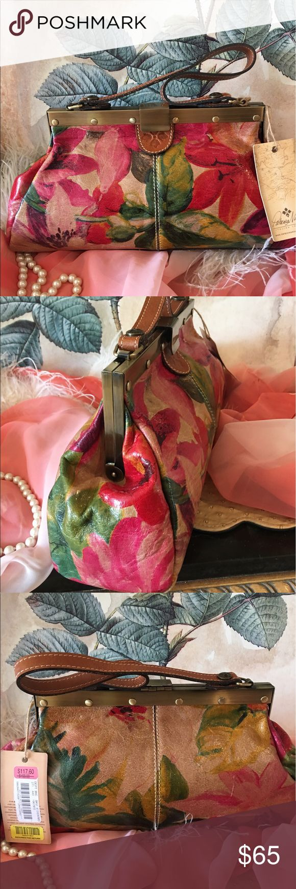 """Patricia Nash Handbag NWT OMG beautiful Patricia Nash NWT gorgeous floral leather satchel style Handbag that is simply beautiful. Measures about 14 1/2"""" across the bottom, 8"""" tall, 3"""" deep across bottom, and strap drop is about 9"""". Beautiful bright colors make this a gorgeous statement bag. I have the matching wallet for sale that is new and I also have a pre-owned zipper cosmetic pouch that is in very good condition if interested. I consider all reasonable offers. Thank you. Patricia Nash…"""