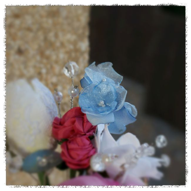 wedding bouquet for Michelle - blue delphinium flowers using vintage crossgrain ribbon, two shades of blue georgette ribbon, with sead pearl centre on silver wire