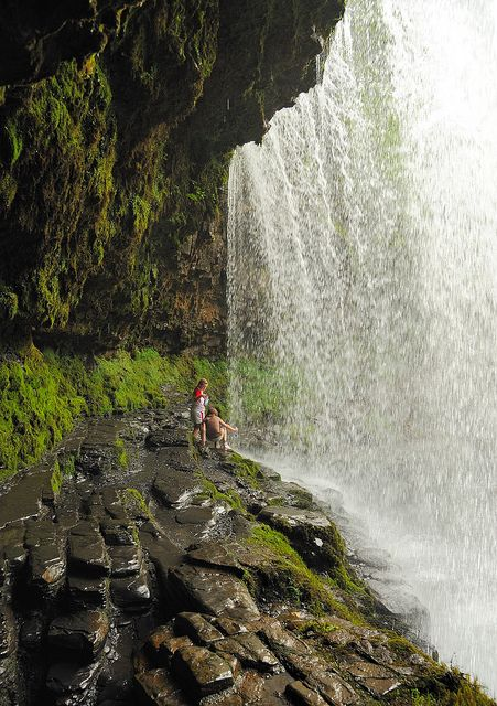 Under the Waterfalls - Ystradfellte, Wales. Walk behind these, they are gorgeous!