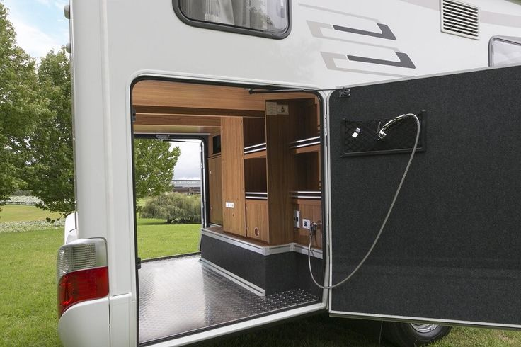 The Hymer ML T580 luxury campervan has a large rear garage with plenty of room for all your toys. Feel free to use this image but give credit to http://smartrv.co.nz/motorhomes-for-sale/german/hymer/ml-t-580-4x4