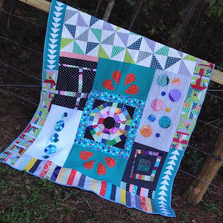 I was finally able to pull this out and finish it. I added a small polka dot, light blue binding and used dot flannel for the backing. With such a busy quilt, I quoted wth simple wavy lines. Thank you all for your contributions. As the weather gets cooler, this has been my go to quilt to pull out and cuddle under and all the colors and crazy dots make me happy, happy, happy! Cheers, Becky