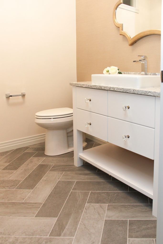 Gray Luxury Vinyl Tile Bathroom Floor In Herringbone Pattern Vinyl Tile Bathroom Luxury Vinyl Tile Vinyl Plank Flooring Bathroom