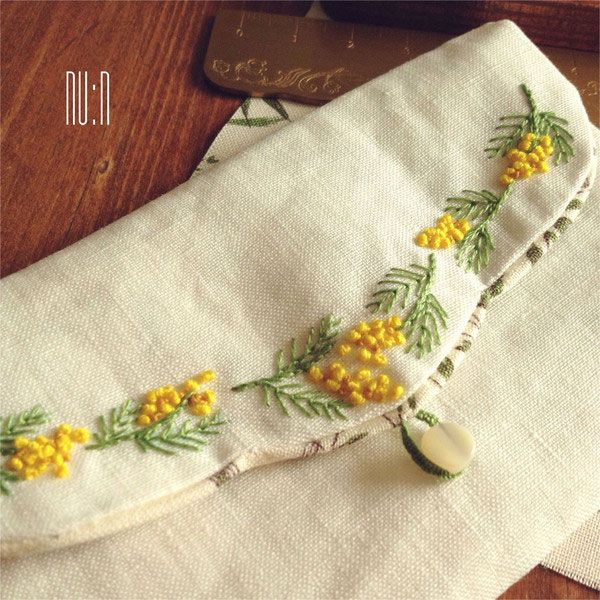 Finished a mimosa mini pouch kit by Jeu de Fils .     * Mimosa Mini Pouch *  Kit  Mimosa Mini Pouch  by Jeu de Fils     Mimosa embroidery.