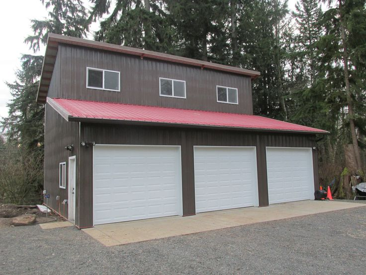 Post Frame Three Car Garage With Storage Loft In Monroe, WA. Constructed By