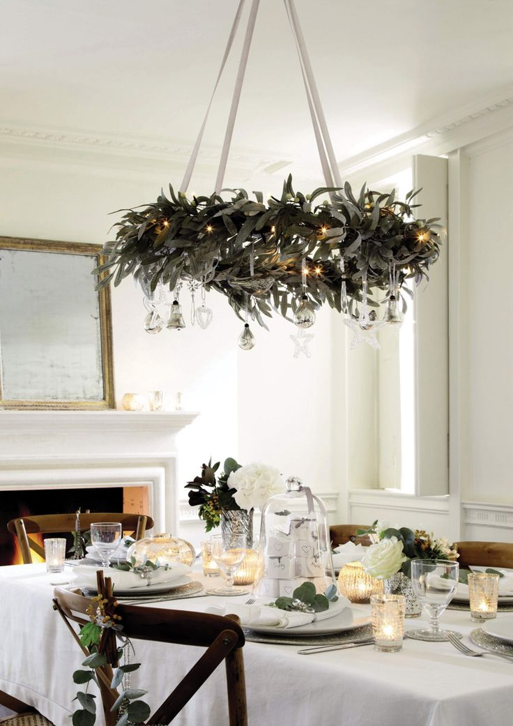 holiday decor hanging wreath chandelier tablescape