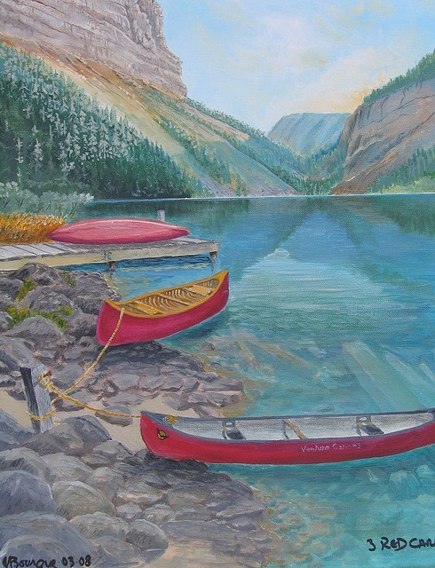 3 Red canoes sitting near a  clear mountain lake