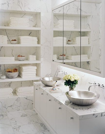 bathrooms - marble tiles backsplash white floating shelves white cabinet marble countertop twin stainless steel round vessel sinks wall-mount faucets medicine cabinet