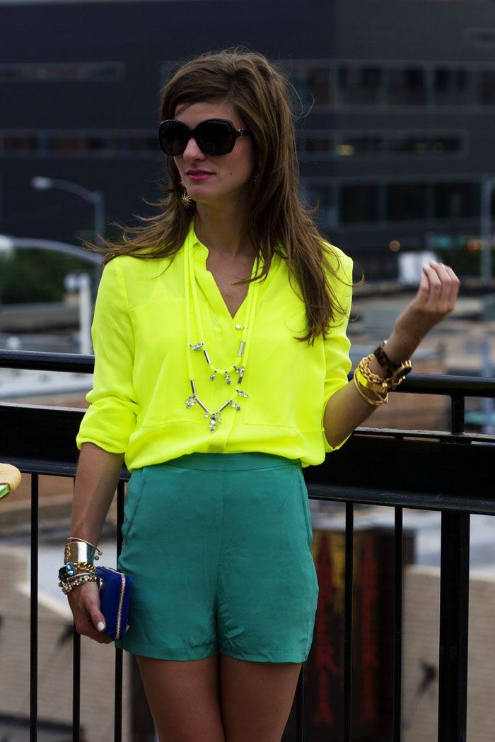neon yellow blouse + green shorts + cobal blue clutch.