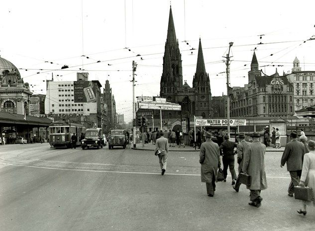 HISTORY: City commuters walk towards Princes Bridge and Flinders Street Railway Stations, 1959 (photo by Wolfgang Sievers). Image courtesy of the State Library of Victoria.