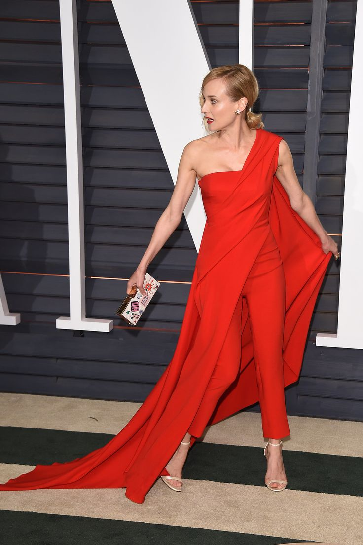 The actress mixed things up at the Vanity Fair Oscars party with a red caped pantsuit and graphic clutch. How chic!