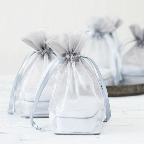 A stylish favor bag with an envelope style closure, this Italian made favor bag is a popular choice for packaging candies or little treats.  Great for weddings, showers and holiday parties.  Available in soft ivory and white.. Customize with our designer labels or decorate with ribbon and custom hang tags.