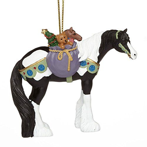 From the Trail of Painted Ponies 2015 Holiday Ornaments Collection, Gypsy Winter Dreams Christmas Ornament. This Gypsy Vanner Stallion is carrying a bag of toys and goodies on its back.