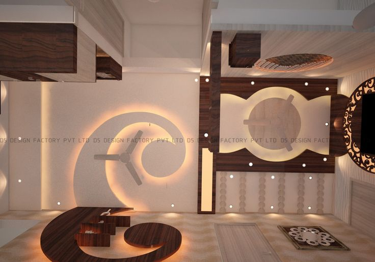 In the living area the TV unit had a unique round shaped laser cut panel flaked by teak work and this design flow was carried on to the ceiling where grooved false ceiling was covered with wooden panels that looked as if the wall unit has been carved out of it.