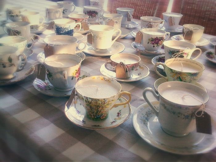Various teacup candle designs