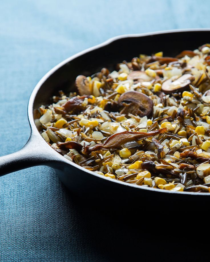 Use hand-harvested wild rice to make this sauté, filled with two types of earthy mushrooms and fresh summer corn. Part of Lois Ellen Frank's Native American feast.