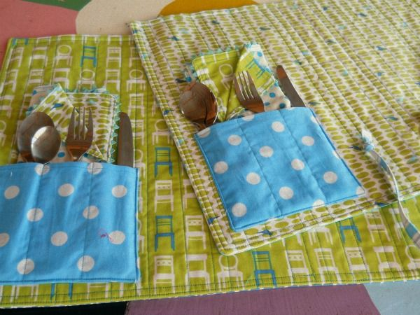 love these fabrics/colors and the idea of rolling up a placemat with utensils & napkin to take outside/on a picnic! would be cool in laminated fabric too!