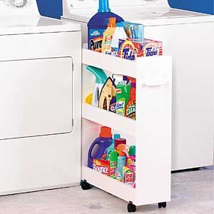"Roll-Out Laundry Caddy nestles between washer and dryer in a compact three-shelf design. Raised side rails keep everything in place. Sturdy melamine, dual track casters. Assembly required. 25 x 8 3/8 x 31""."