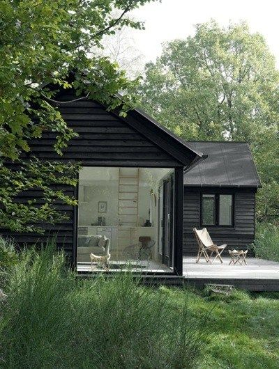 38 contemporary residences with exteriors clad in, painted, and in some cases weathered to the darkest black.